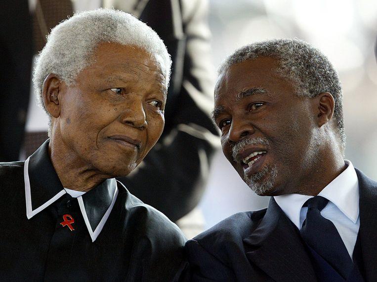 Thabo Mbeki en Nelson Mandela in 2003. Beeld epa