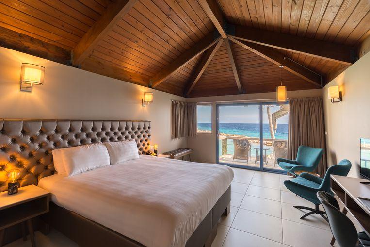 Een slaapkamer in het Avila Beach Hotel.  Beeld null