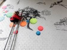 Kleurrijke street art moet viaduct Brummen opvrolijken