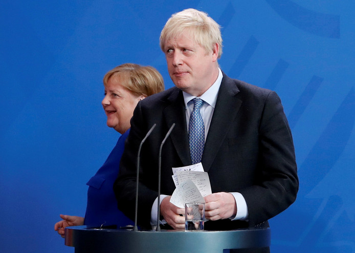 Premier Johnson en bondskanselier Merkel tijdens een persconferentie in Berlijn in augustus van dit jaar.