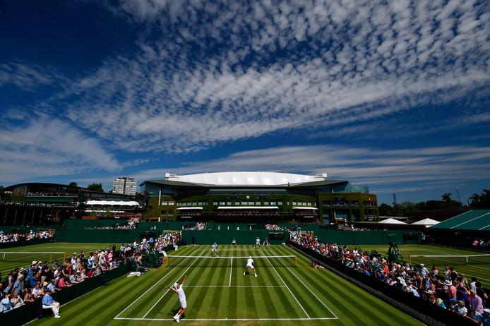 Jean-Julien Rojer en Horia Tecau in actie op Wimbledon.