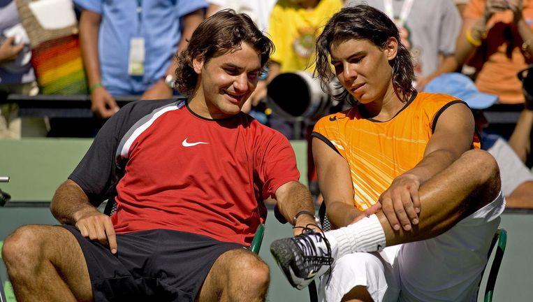 Federer (l) en Nadal tijdens hun tweede treffen, maart 2005. Beeld Getty Images