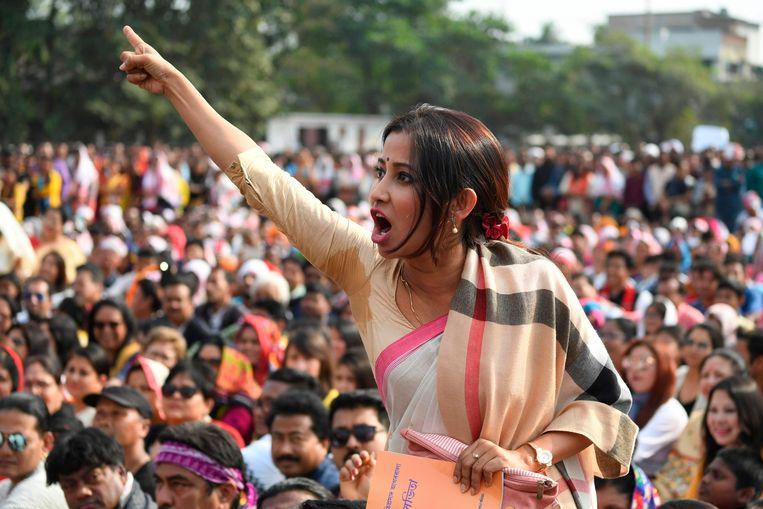 Een vrouw schreeuwt tijdens een demonstratie in Guhawati, Assam. Beeld AFP