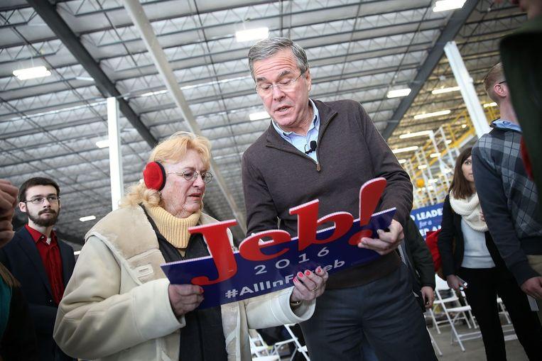 Oud-gouverneur Jeb Bush op campagne in Grinnell in Iowa. Hij richt zich nu vooral op de strijd in New Hampshire. Beeld null