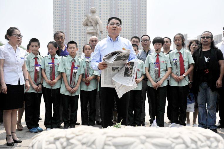 Chen houdt een speech met The New York Times in zijn handen. Beeld Ding ge - Imaginechina