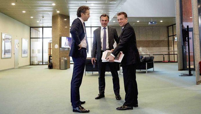 Dijsselbloem, Harbers (VVD) en Merkies (SP) tijdens de eerste dag van de Algemene Financiële Beschouwingen. Laatstgenoemde kreeg het aan de stok met PVV'er Van Dijck.