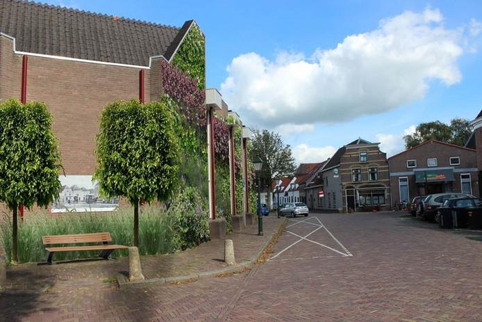 Bij een hoosbui staan delen van de Oudewaterse binnenstad blank.