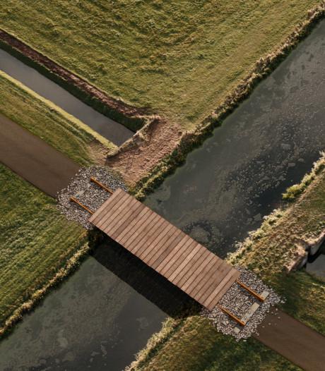 Fietsbrug van oude spoorrails aangeboden aan Zwijndrecht