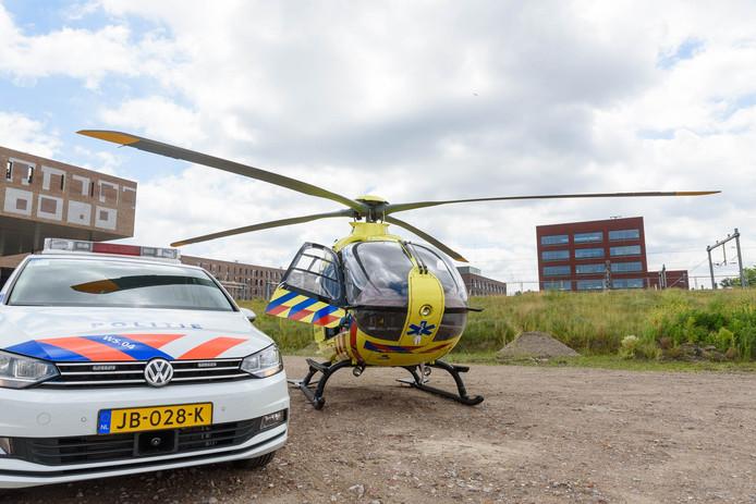 De man was van de loopbrug bij het station van Breda gevallen.