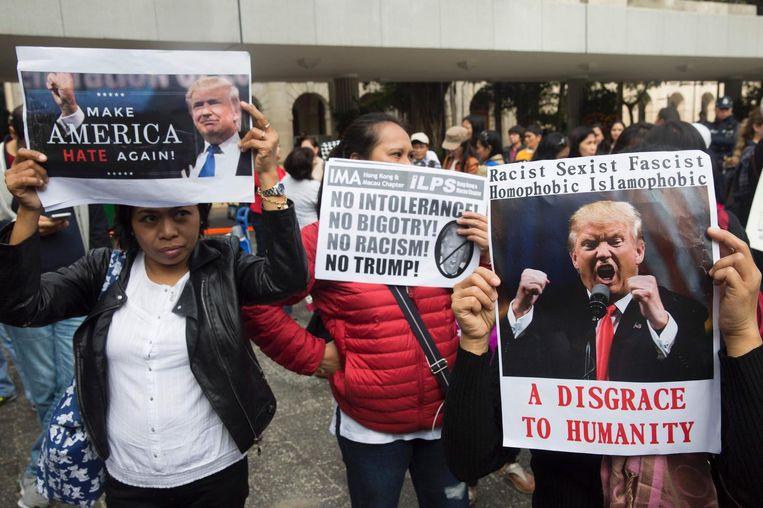Protesten in Hongkong tegen Trumps migratieplannen. Beeld reuters