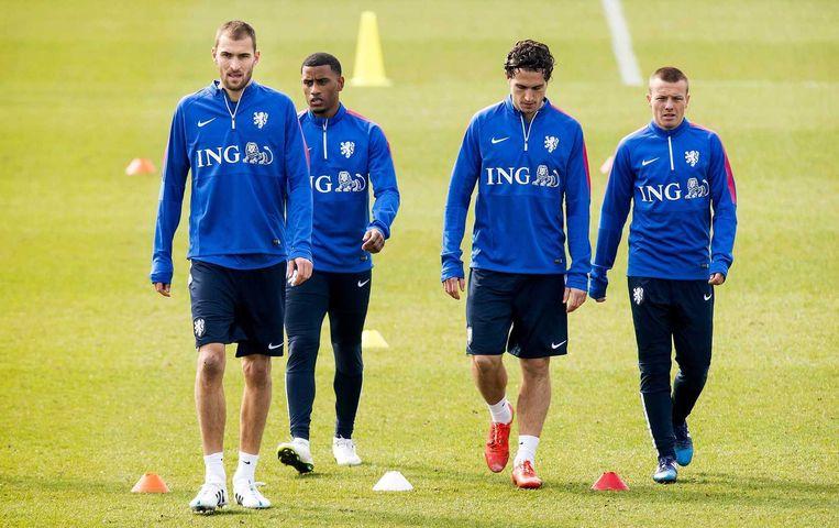 Bas Dost, Luciano Narsingh, Daryl Janmaat en Jordy Clasie tijdens de training van Oranje. Beeld anp