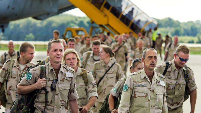 Militairen komen in 2010 aan op de luchthaven van Eindhoven, na maanden in Uruzgan Beeld ANP