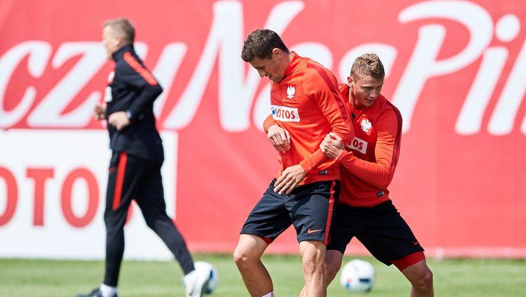 Pavel Wszolek (links) op training met de nationale ploeg.