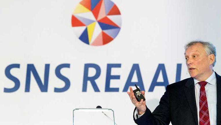 Bestuursvoorzitter Gerard van Olphen presenteert de jaarcijfers van SNS Reaal over 2013. Beeld null