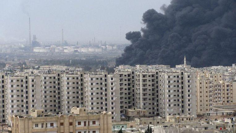Rook stijgt op na gevechten in Homs. Beeld reuters