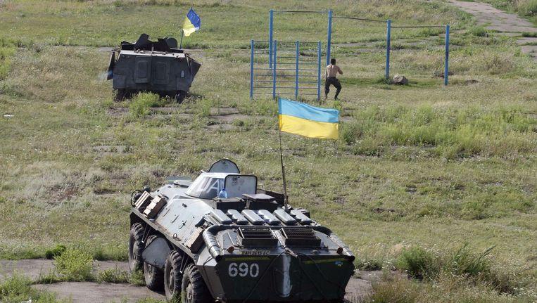 Gevechtsvoertuigen van het Oekraïense leger in de omgeving van Loehansk. Beeld AFP