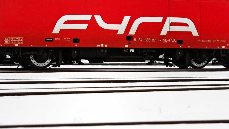 Een Fyra-treintoestel in de sneeuw bij op een rangeerterrein bij Amsterdam-Watergraafsmeer Beeld ANP