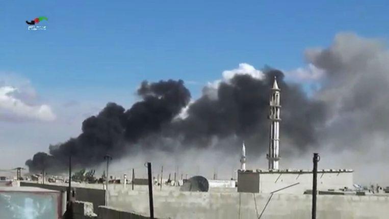 Archiefbeeld: rook na luchtaanvallen in Homs in 2015.