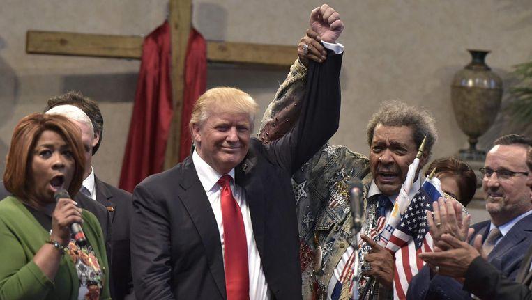 Presidentskandidaat Donald Trump met bokspromoter Don King. Beeld afp