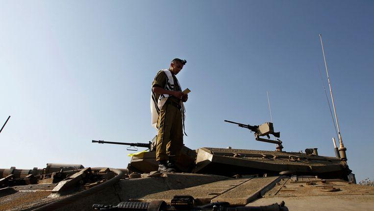 Een Israëlische soldaat vlakbij de grens met Syrië Beeld REUTERS