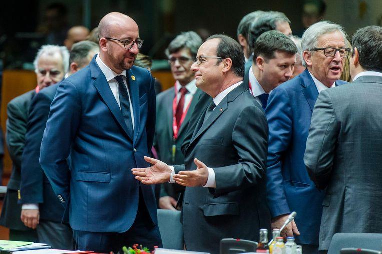 Premier van België Charles Michel en Frans President Francois Hollande tijdens de Europese Top, waar de lidstaten spreken over het associatieverdrag met Oekraïne. Beeld anp