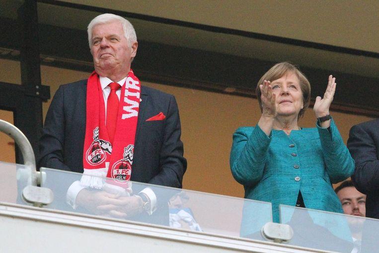 Angela Merkel is toeschouwer bij een Bundesliga-wedstrijd tussen FC Köln en Eintracht Frankfurt, 2017. Beeld BSR Agency