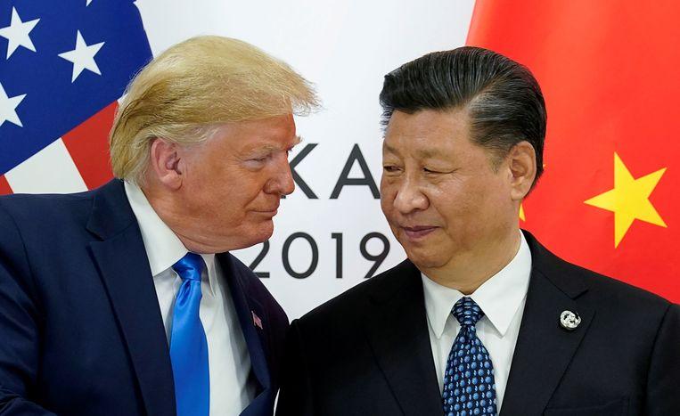 President Donald Trump ontmoet zijn Chinese ambtgenoot Xi Jinping tijdens de G20 in Osaka, Japan.  Beeld Reuters