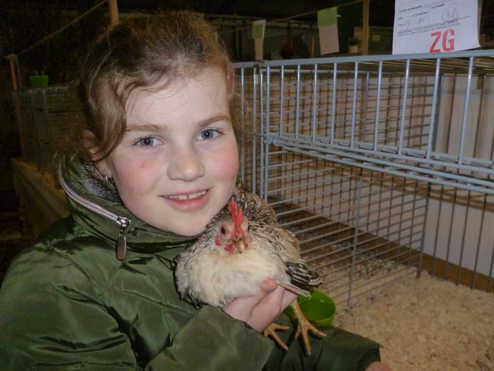 Lieke de Groot (7) uit Milheeze met haar lievelingskip Snoepje.