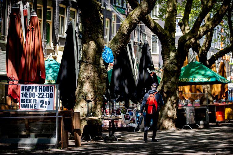 Lege terrassen in het centrum van Amsterdam. Beeld ANP