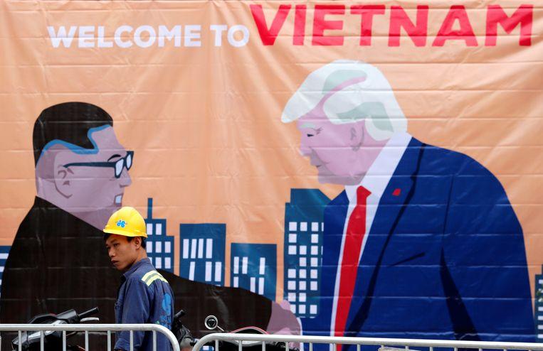 Een spandoek van de Noord-Koreaanse leider Kim Jong Un en de Amerikaanse president Donald Trump. Beeld REUTERS