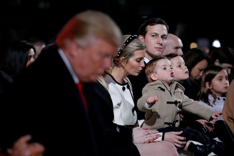 White House senior advisor Jared Kushner, seated with his wife White House senior advisor Ivanka Trump and their children, looks over at U.S. President Donald Trump as he bows his head during the prayer at the National Christmas Tree lighting ceremony near the White House in Washington, U.S. November 30, 2017.  REUTERS/Jonathan Ernst