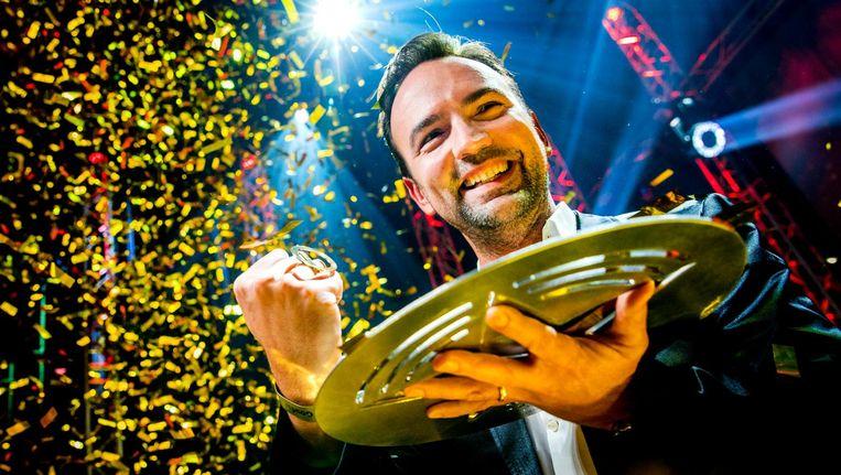 Gerard Ekdom met de Gouden RadioRing Beeld anp
