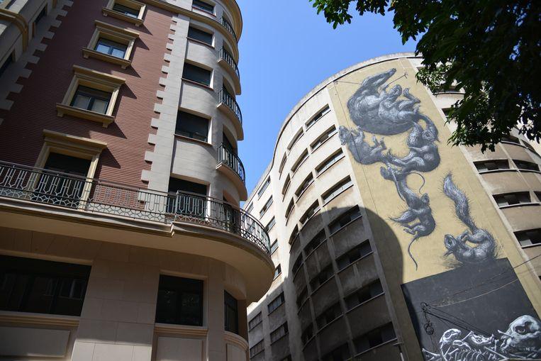 Kunstwerk van de Belgische kunstenaar ROA in de wijk Soho. Beeld Eric van den Berg