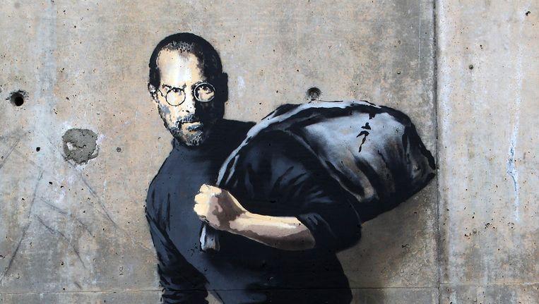 Graffittitekening van Steve Jobs, door Banksy. Jobs is de zoon van een Syrische immigrant. Beeld AP