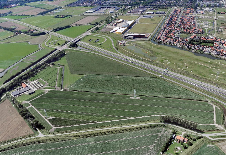 Het gebied tussen de A58 en de Trekdijk voorgrond is bestemd voor bedrijfsvestiging.