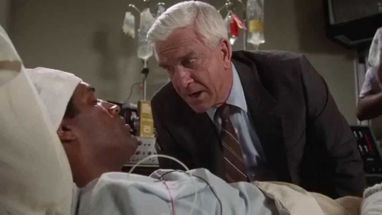 O.J. Simpsons en Leslie Nielsen in The Naked Gun: From the Files of Police Squad! (1988). Beeld