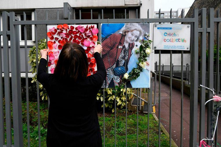 In de buurt van haar woning hing een foto van de vrouw. Beeld AFP