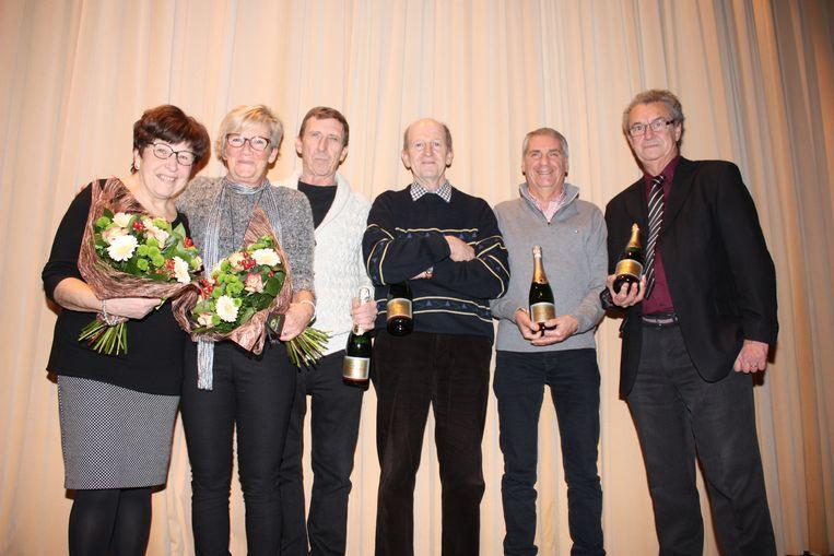 Enkele gepensioneerde ambtenaren werden in de bloemetjes gezet in De Haan.