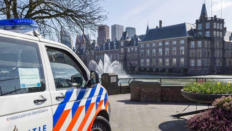 Een politieauto in Den Haag Beeld anp
