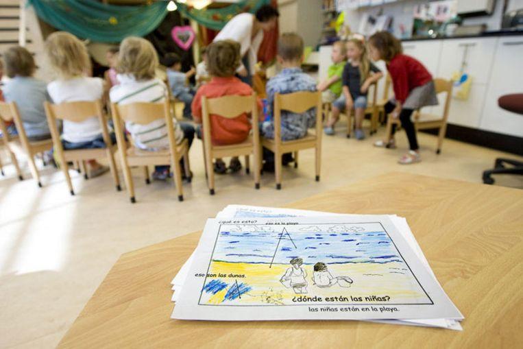 Soms kennen kinderen in Amsterdam amper tweehonderd Nederlandse woorden, tegen tweeduizend bij hun Nederlandse leeftijdgenootjes. Foto GPD Beeld