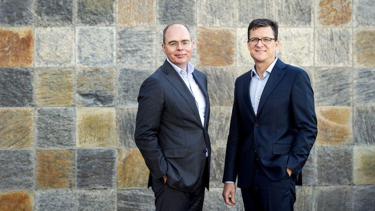 Baptiest Coopmans (L), CEO van Ziggo, en Rob Shuter, CEO Vodafone Nederland. De bedrijven fuseren hun Nederlandse activiteiten. Beeld anp