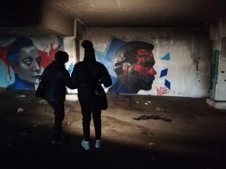 Portretten van straatkunstenares Anopsy in parkeergarage Kempering. Beeld Patrick Meershoek