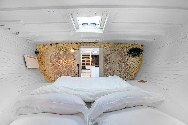 De slaapkamer van hotel Asile Flottant Beeld Zanca fotografie