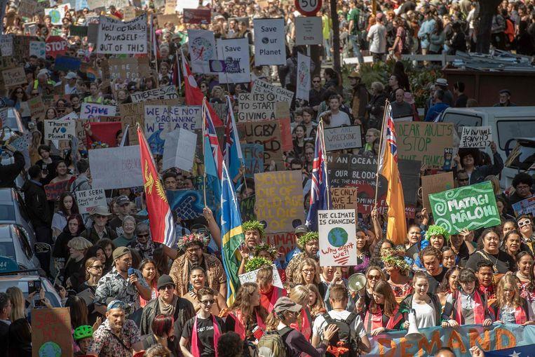 Klimaatmars in Wellington. In verschillende steden in Nieuw-Zeeland, waar de wereldwijde klimaatmars van start ging, was de opkomst groot. Beeld AFP