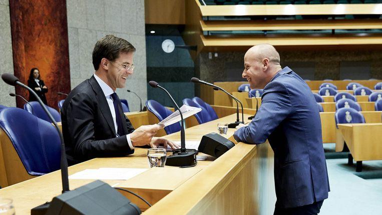 Premier Mark Rutte en Mark Verheijen (R) in de Tweede Kamer Beeld anp
