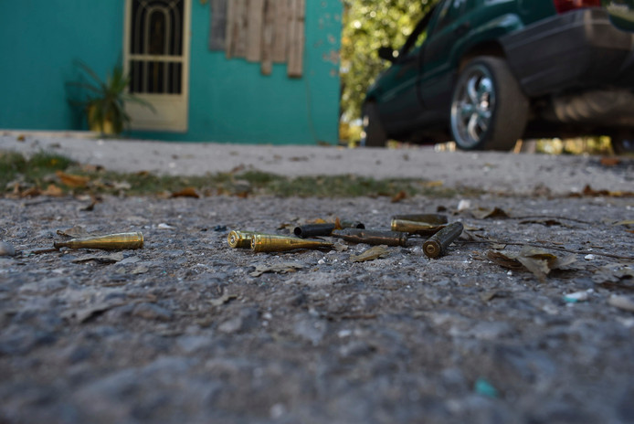 Spent bullet casings lay on the street after a gun battle between Mexican security forces and suspected cartel gunmen, in Villa Union, Mexico, Sunday, Dic. 1, 2019. Mexican security forces on Sunday killed seven more members of a presumed cartel assault force rolled into a town near the Texas border and staged an hour-long attack, officials said, bringing the death toll to at least 21. (AP Photo/Gerardo Sanchez)