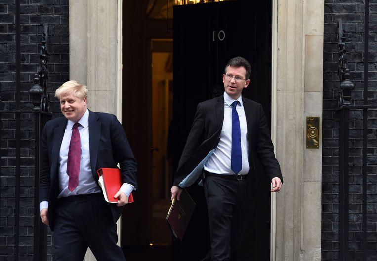 De Britse ministers Boris Johnson (Buitenlandse Zaken) en Greg Clark (Economische Zaken). Beeld EPA