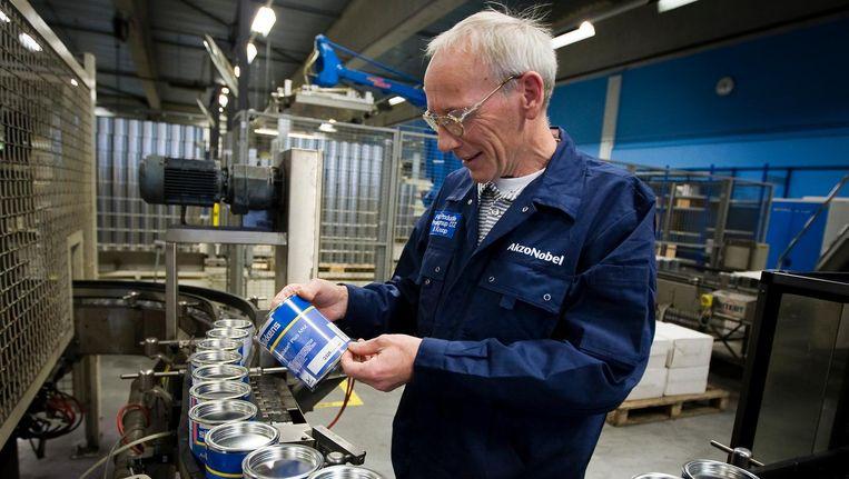Een overname van AkzoNobel door PPG zal volgens Akzotopman Büchner duizenden banen kosten Beeld anp