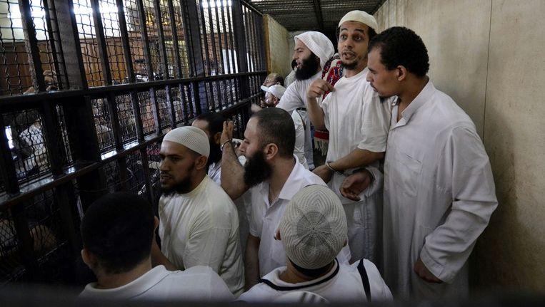 Militanten islamieten die beschuldigd worden van gevangenisaanvallen in 2011. Beeld EPA