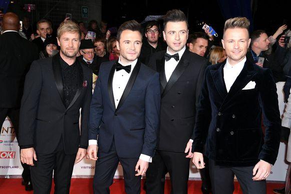 Westlife-zanger Markus Feehily, tweede van rechts, is verloofd.